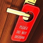 do-not-disturb-sign-hanging-on-a-hotel-door-handle-3d-illustration