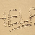 help-sign-beach-written-sand-43499890