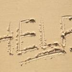 help-sign-beach-written-sand-43499890