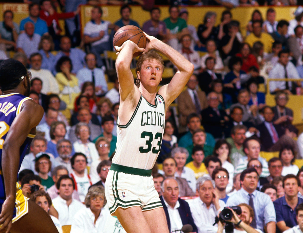 Larry Bird #33 of the Boston Celtics shoots a jumpshot against James Worthy of the Los Angeles Lakers during the NBA game at The Boston Garden on January 1, 1987 in Boston, Massachusetts. Andrew D. Bernstein/NBAE/Getty Images)